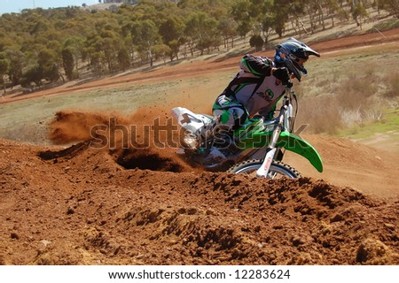 Motocross rider accelerating out of a corner