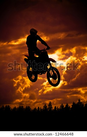 motocross rider in a dirt track race - stock photo