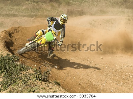 motocross rider in action - stock photo
