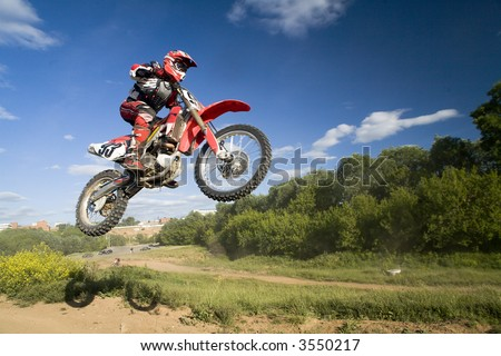 Motocross rider in the air 5 - stock photo