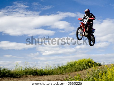 Motocross rider in the air 11