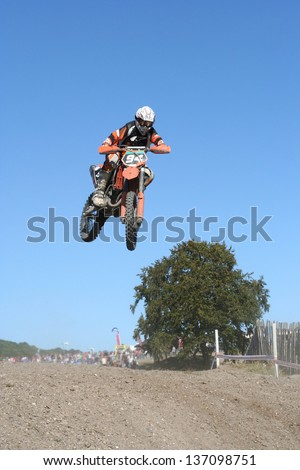 Motocross Rider Takes a Jump
