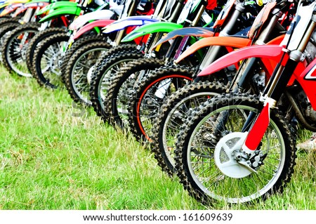 Motocross riders lined up before start on the race - stock photo