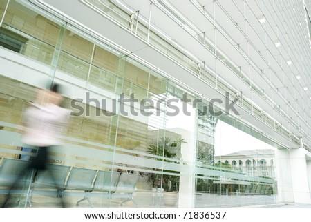 moton blur of people walking in blue tone - stock photo