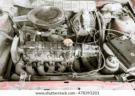 motor and hoses under the hood of car