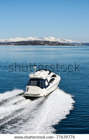 Motor boat at in sea landscape at spring - stock photo