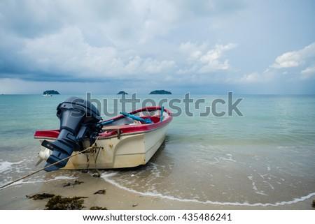 Motor boat docking on the beach - stock photo