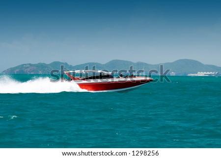 Motor boat in the bay - stock photo
