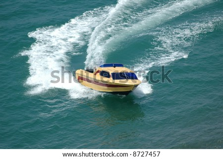 Motor boat making a turn in the sea - stock photo
