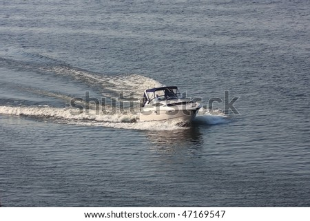 Motor boat moving at high speed on the river