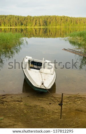 Motor boat near the shore of  lake Seliger. Russia, Tver area - stock photo