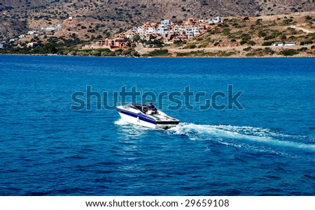 Motor boat speeding - stock photo
