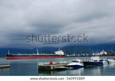 Motor boats and cargo ships at Batumi sea port.City is popular tourist destination