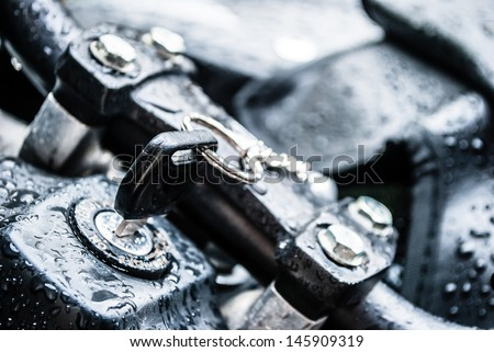 motor cycle keys installed into the ignition lock  - stock photo