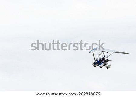 Motor glider in the sky - stock photo