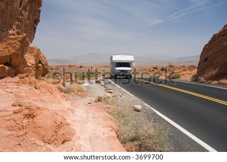 Motor home on desert highway - stock photo