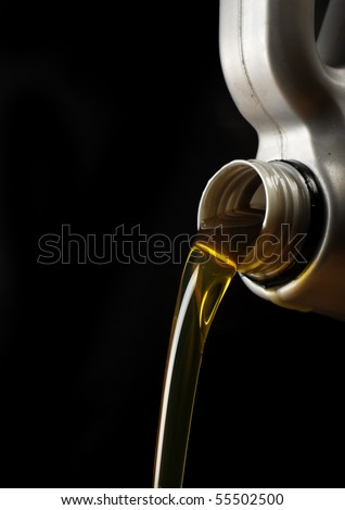 Motor oil poring - stock photo