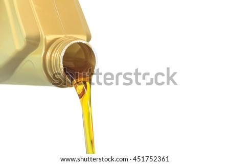 Motor oil pouring on white background - stock photo