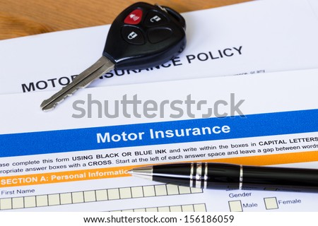 Motor or car insurance application with pen and car key - stock photo