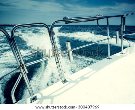 Motor power boat speeding on the Atlantic Ocean. Vacation, summer, travel, water sports,  lifestyle concept, boat rental and sales concept. - stock photo