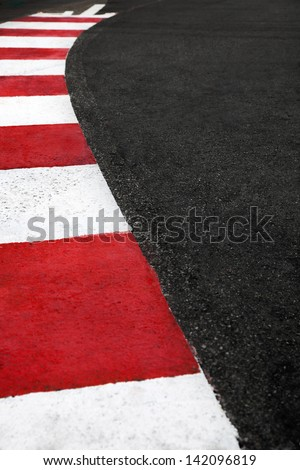 Motor race asphalt and curb on Monaco Montecarlo Grand Prix street circuit - stock photo