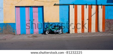 Motor scooter on colorful street of tropical island