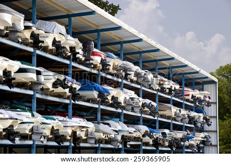 Motor Speed Boats In Garage System - stock photo