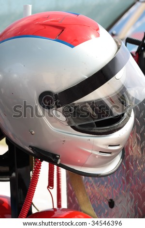 Motor-sports racing helmet. Waiting for the driver.