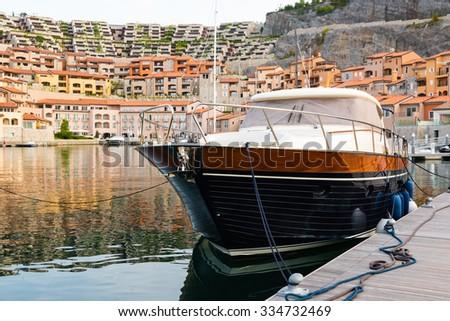 motor yacht in a marina - stock photo