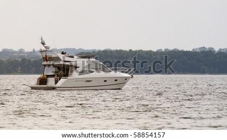 Motor Yacht near the coastline of Mecklenburg (Germany) - stock photo