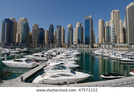 Motor Yachts at Dubai Marina, United Arab Emirates - stock photo