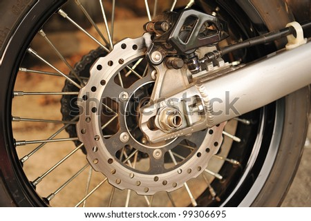 Motorbike engine disk brake - stock photo