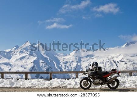 Motorbike in Grossglockner high alpine road, National Park Hohe Tauern, Austria - stock photo