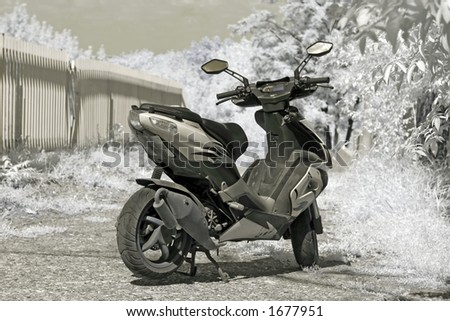 Motorbike resting - infrared photo - stock photo