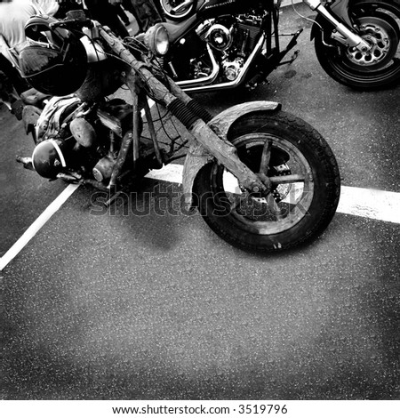 motorbikes in black and white on asphalt to use as background or cd cover - stock photo