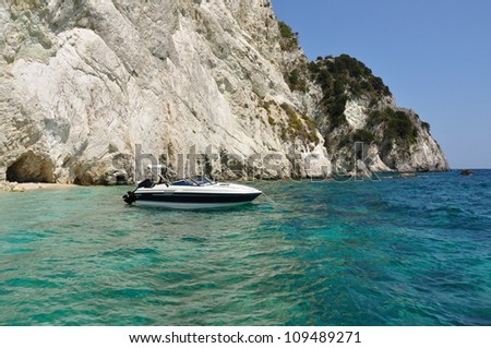Motorboat anchored on remote beach in Zakynthos, Greece. - stock photo