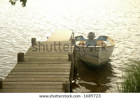 motorboat at the dock - stock photo
