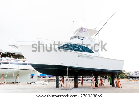 Motorboat at the shipyard for maintenance - stock photo
