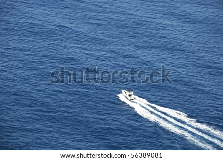 Motorboat crossing ocean - stock photo