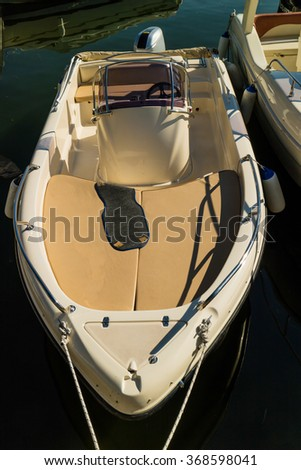 """Motorboat in marina, with calm blue sea. Gardasee, Italy, boat for rent. """"selected focus, narrow depth of field"""" - stock photo"""