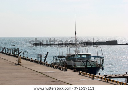 motorboat moored in a marina - stock photo