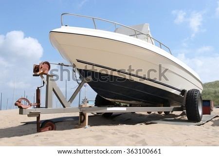 motorboat on trailer - stock photo