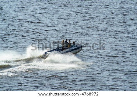 motorboat speeding in the sea - stock photo