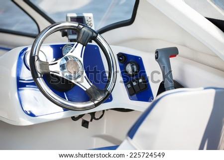 motorboat steering wheel - stock photo