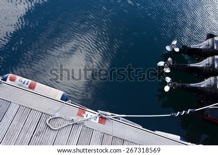 Motorboat with three engines out the water in the dock. - stock photo