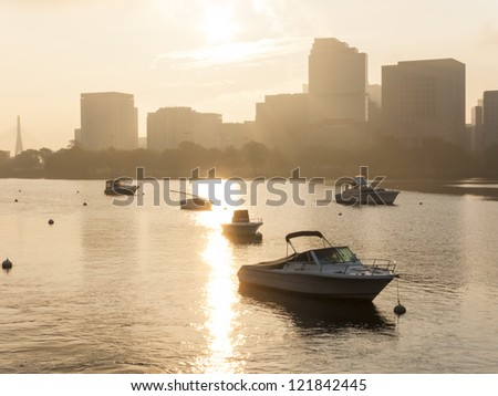 Motorboats anchored in the Charles River in Boston, MA. - stock photo