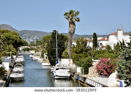 Motorboats moored in a canal of the marina of Empuriabravia, commune on the Costa Brava at northeastern Catalonia in Spain - stock photo