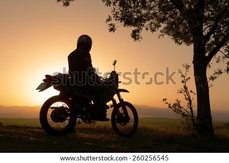 motorcross rider silhouette - stock photo