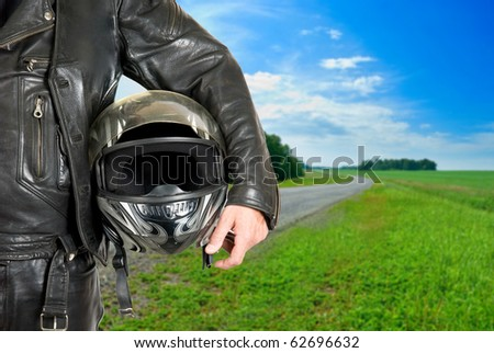 motorcycle biker with helmet closeup on a road