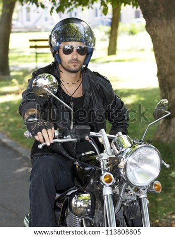 Motorcycle chopper rider with helmet - stock photo